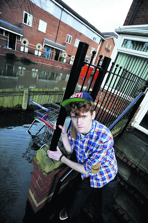 Tom Horton, 18, on the steps at the block of flats where he lives in Osney Court
