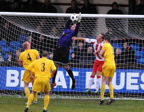 Oxford City keeper Matt Ingram claims a corner against Brackley