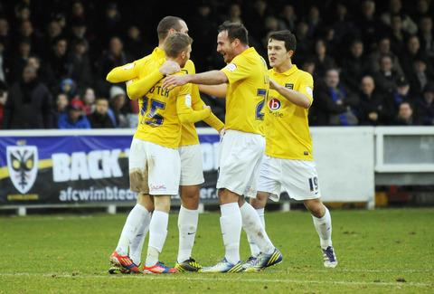 Oxford Mail: Lee Cox (right) joins the celebrations for Alfie Potter's goal