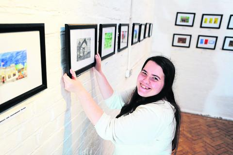 Oxford Mail: Artist Jenny Doyle at the Jam Factory with her exhibition of paintings about The Goodies. Picture: OX56611 Jon Lewis