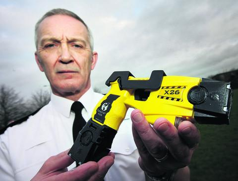 Oxford Mail: Supt Tony Ismay with a Taser at Bicester traffic base