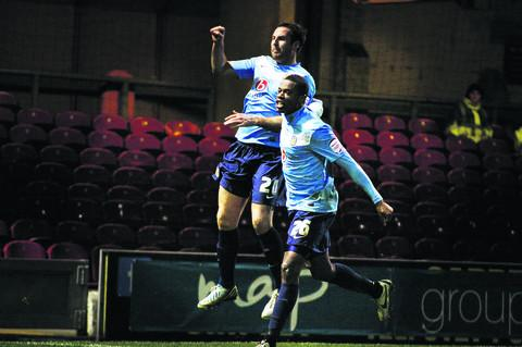 n ON A HIGH: Peter Leven celebrates his late penalty with Oxford teammate Liam Davis as the U's record a 2-1 win at Bradford to make it eight successive npower League Two games unbeaten