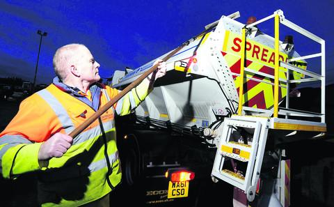 Alan Hutt, a road worker at Drayton Highways Depot, gets a gritter lorry ready for the night shift on Oxfordshire's roads last night