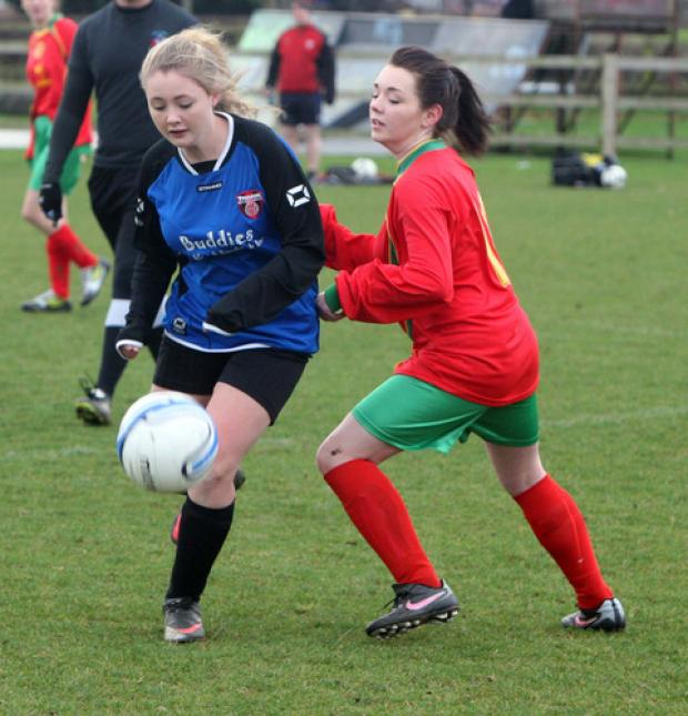 Thame goalscorer Bexx Harris (left) beats Carterton's Megan Cole to the ball during their Under 12 League Cup clash