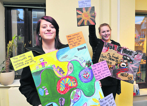 Natasha Greenway, left, and Emily Dawson with their art