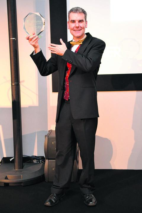 Jamie McIntyre pictured presenting the 'Green Business' category at the 2012 West Oxfordshire Business Awards
