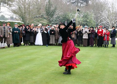 Frilford Heath's new lady captain Sue Russell, dressed in period costume to commemorate the club's centenary, drives in