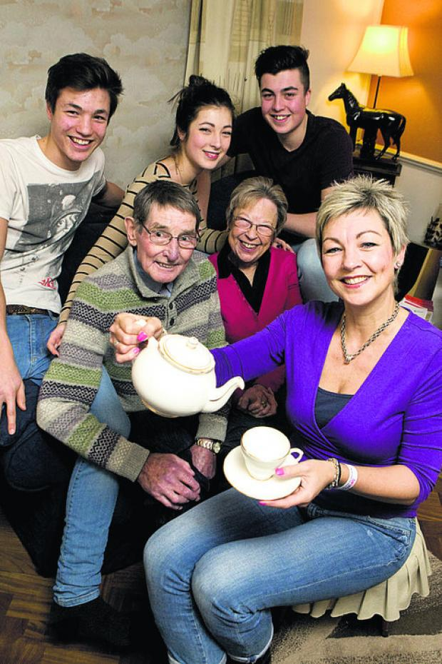 Oxford Mail: Wendy Taylor, front, who is raising funds for Cancer Research UK, pictured with her children, back from left, Joe, Carrie and Caillin, and her parents Chas and Margaret McHugh