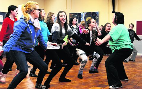 Cast members gathered at the 10th Oxford (Marston) Scout HQ for rehearsals for the Oxfordshire Gang Show 2013. Chelsey Bishop and Dannielle Merry, both 15, left, and second left, and choreographer Kim Griffiths, right