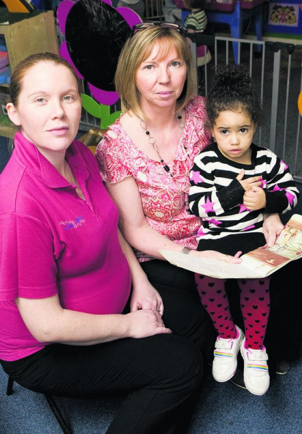 Oxford Mail: Tiny Toes nursery manager Louise Rose, left, nursery owner Margaret Webster and Princess-Ivorhy Jasmin.  Picture: OX57063 Antony Moore