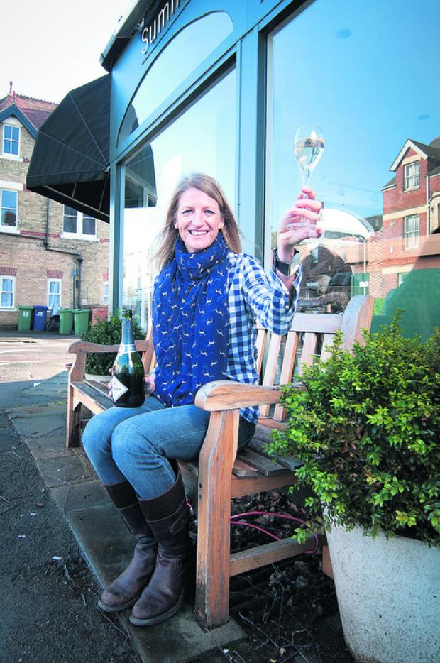 Louise Ferreira outside the wine cafe in Summertown. Picture: OX57074 Andrew Walmsley