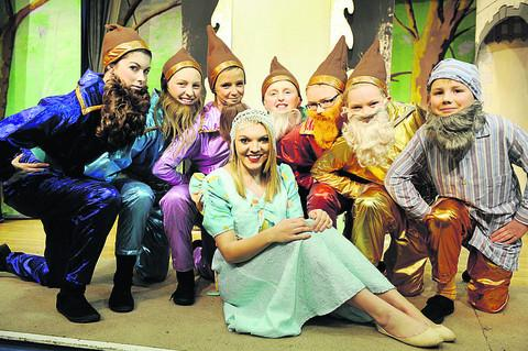 From left, the seven dwarfs are Colette Keogh-Green, Emily Cox, Leah Odley, Abigail Rolston, Lizzi Hayman, Honor Varnom, and Danny Williams with Grace Varnom as Snow White