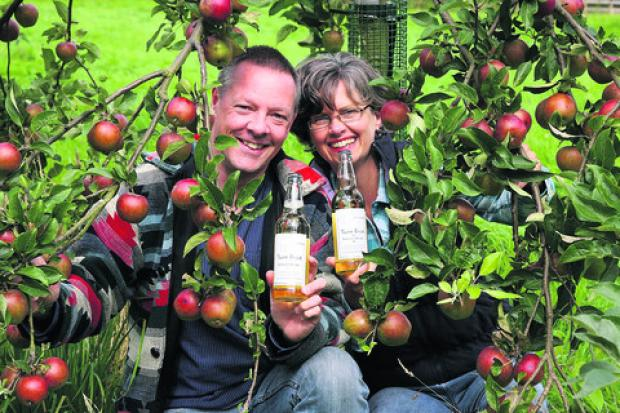 Tony Harrison and Jo Dakin at their 10-acre orchard near Warmington