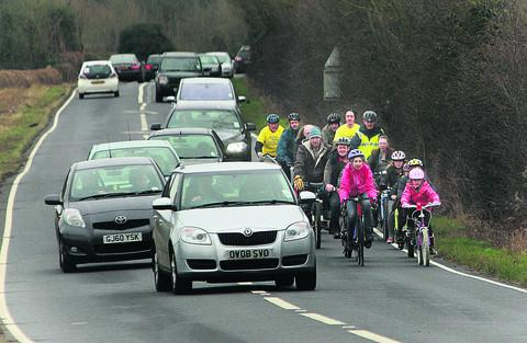 Oxford Mail: Campaigners cycling along the busy B4044 near Farmoor
