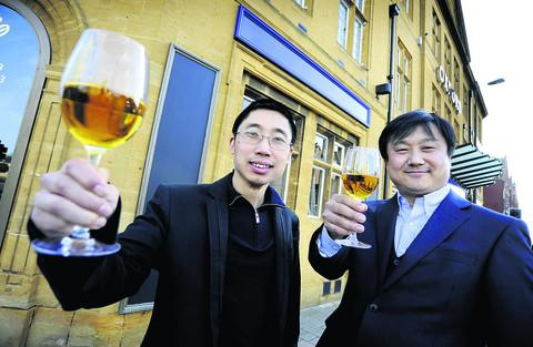 Tao Tao, left, and Min Quan outside their new restaurant