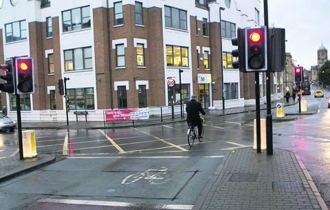 A cyclist goes through a red light at the junction of St Aldate's and Thames Street