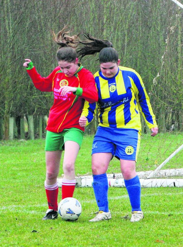 Carterton's Tatty McIntyre (left) battles with Didcot Casuals' Isla Nugent