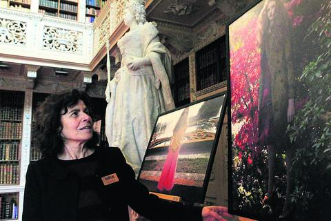 Antonia Keaney with pictures from a fashion shoot in the Lights, Camera, Action exhibition at Blenheim Palace. Picture: OX57307 Ric Mellis