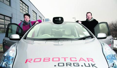 Prof Paul Newman, left, and Dr Igmar Posner with the robot car