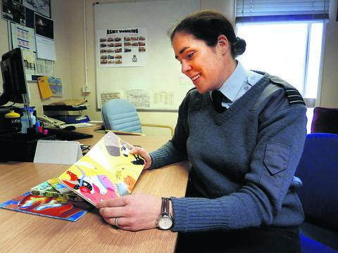 Wing Commander Angela Baker, who reads daily to her two children, in her office in RAF Brize Norton. Picture: Tom Jennings