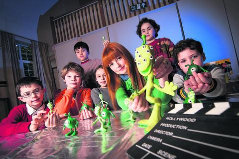 Animator Emma Dougherty, pictured centre, with the pupils. Picture: OX57348 Andrew Walmsley