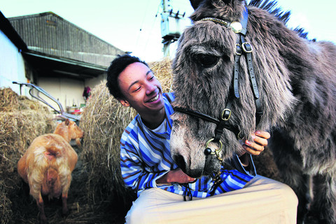 Chris Young who plays Jesus, with Tracey the donkey. Picture: OX57408 Ed Nix