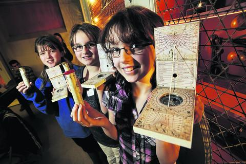 Lily, Grace and Eve Gilmour with their pocket sundials. Picture: OX56826 David Fleming