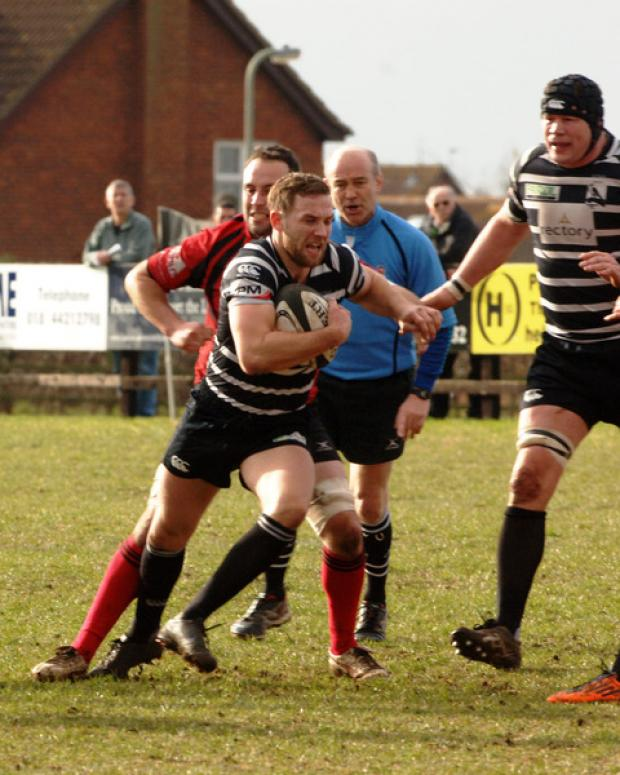Chinnor scrum half Frank Jones attacks against Redruth