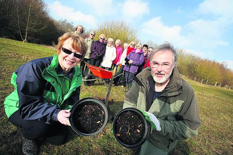 President of West Witney WI Sandra Fenton and chairman of Witney Woodland Volunteers Terry Ewart with the saplings being planted to celebrate the Queen's Jubilee   Picture: OX57321 Damian Halliwell