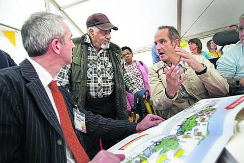 TV show presenter Kevin McCloud, right, talks with Andrew Smith of housing group GreenSquare and resident Arthur Preddie at a previous meeting about the development