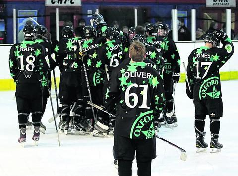 Oxford City Stars' players celebrate their seventh straight win at Wightlink Tigers