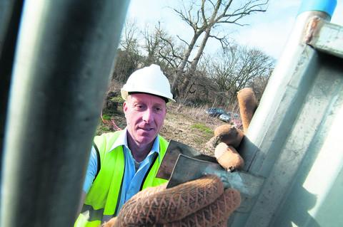 ON SITE: Alan Jackson puts of fencing as building work starts on Maggie's Cancer Centre