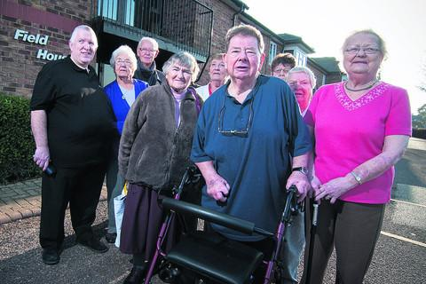 Field House residents including Andy Taylor, left, and Peter Coles, centre, who fear their homes will be demolished