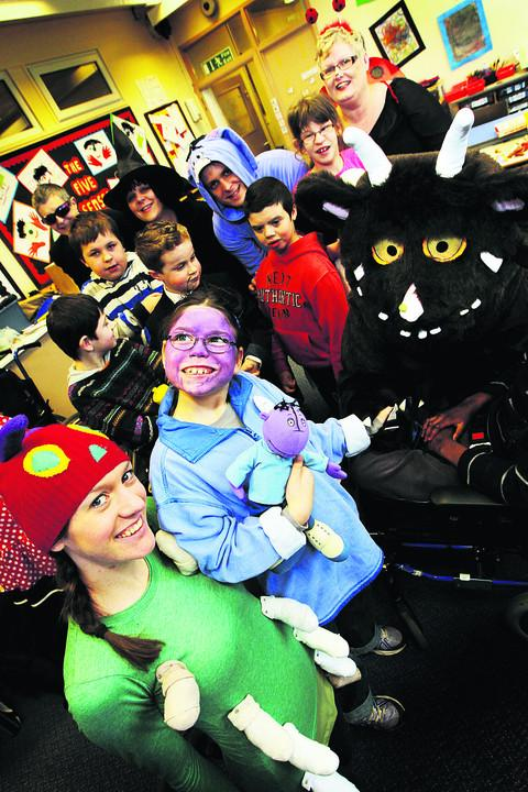 COSTUME DRAMA: The Gruffalo meets children and staff ffrom John Watson School including teaching assistant Rachael Hawks and Judith Stickings, front         Picture: OX57771 Ed Nix