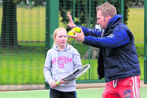 Seth Dixon coaching his daughter Naomi, 11, at the Leys in Witney