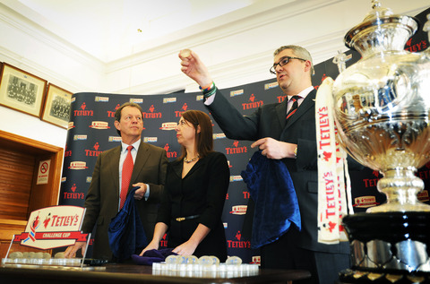Carlsberg's Bruce Ray pulls out Oxford's number during yesterday's Challenge Cup draw as Kevin Whately (left) looks on