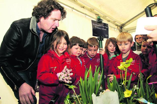 IMPRESSED: Diarmuid Gavin inspects the youngsters' work