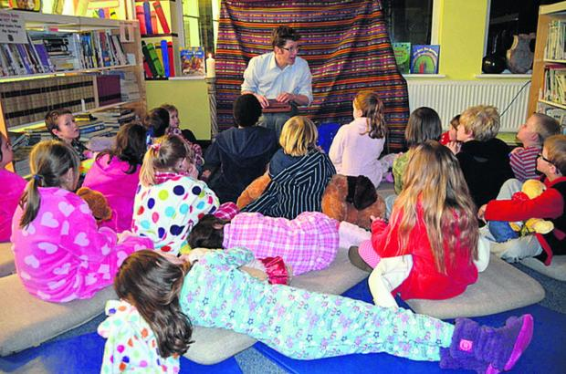Headteacher Tim Edwards-Grundy is pictured leading one of the story sessions
