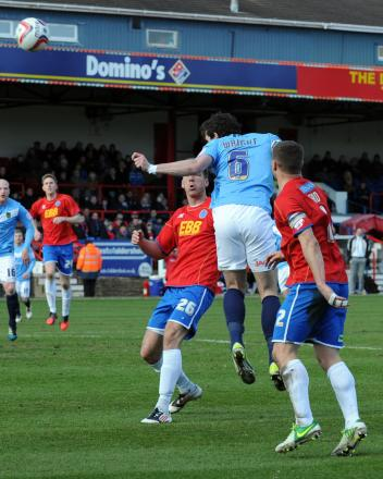 United's Jake Wright sends a late header just wide at Aldershot