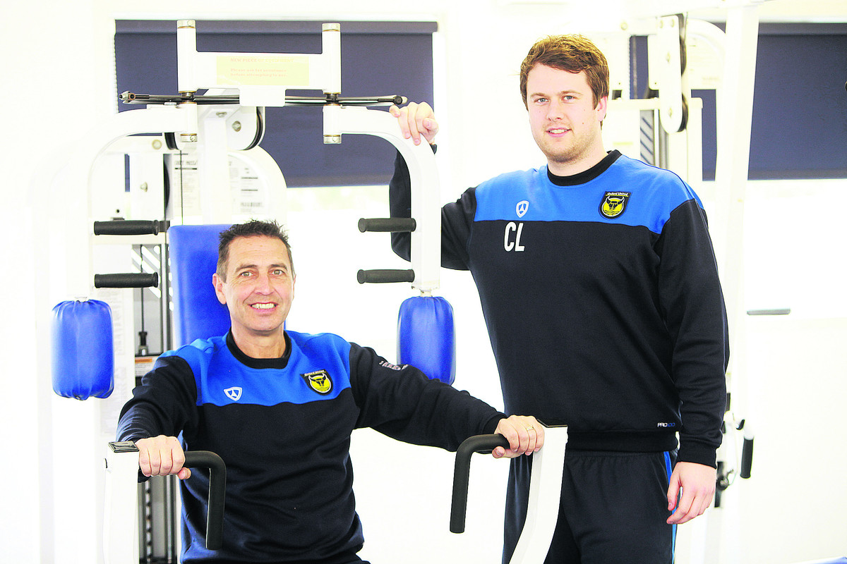 Oxford United football community officer Peter Rhoades-Brown with community manager Chris Lowes at the training ground gym