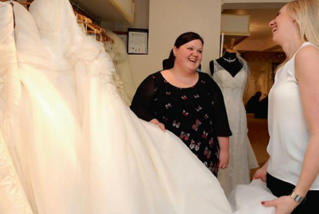 Boutique Owner Hannah Bathe Advises Jemma McCarthy As She Looks At The Gorgeous Dresses Available In
