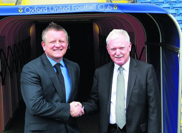 Chris Wilder (left) and Ian Lenagan at the Kassam Stadium yesterday  Picture: Ric Mellis