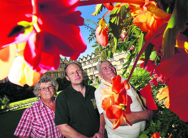 Oxford In Bloom judges, Trish Stevens, left, and John Alcock, right, are shown around the gardens of University College by head gardener Bruce Taylor during last year's contest