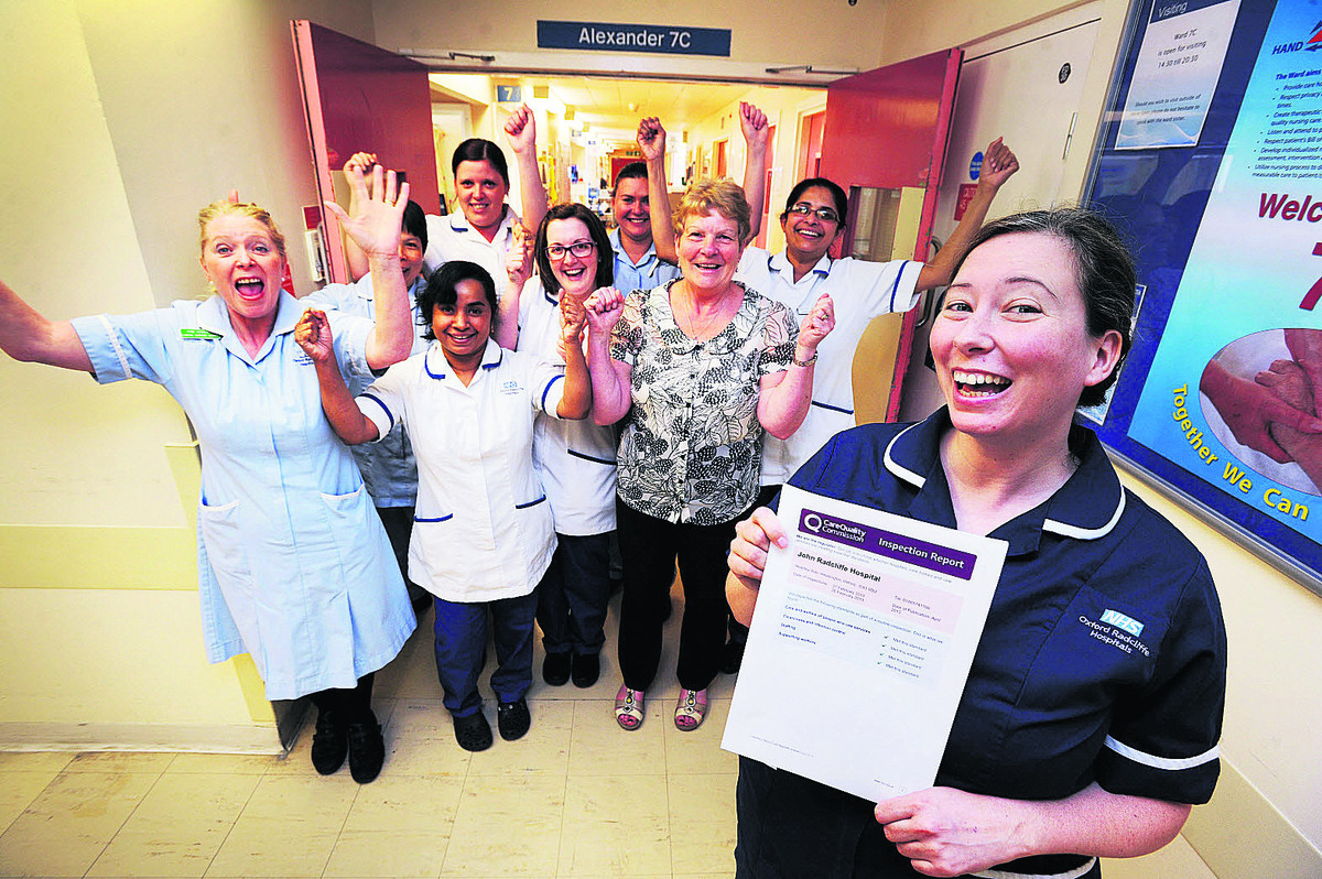 Sister Ginny Mountford, with her team of nurses, clinical support workers and clerk at Ward 7C after successfully passing the latest inspection by the Care Quality Commission