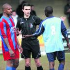 Ivan Gelov (centre) lays down the law in the Sam Waters Cup final