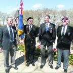 Bugler Ben Horsman, standard-bearer John Grout, Mike Lowe and Don Deaney at the cemetery