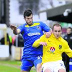 Jonathan Meades tackles Luke O'Brien when Oxford United took on AFC Wimbledon last season