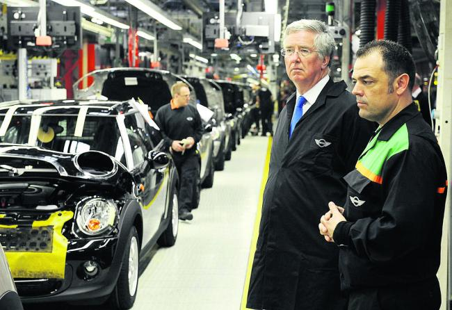 Michael Fallon, left, with BMW worker Andy Hobbs