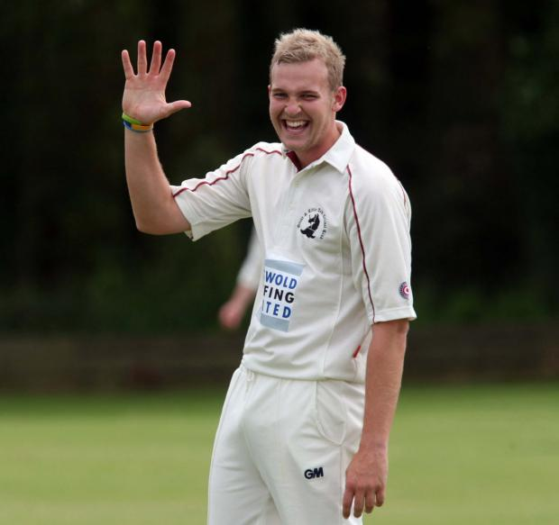 n HIGH A delighted Matt Woods after claiming his final victim in his five-wicket haul