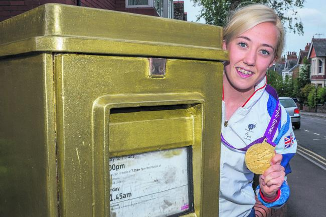 Lily van den Broecke next to her gold postbox in East Oxford. Picture: OX60099 Greg Blatchford